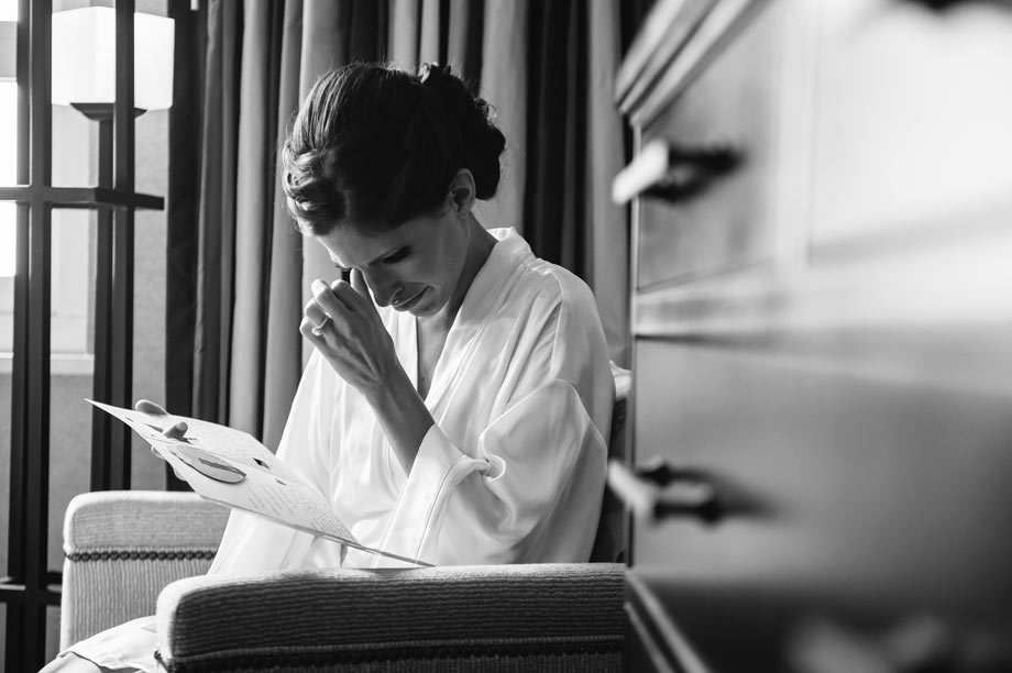 bride crying while reading letter