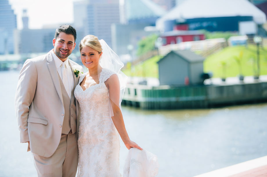 bride and groom posing at baltimore inner harbor