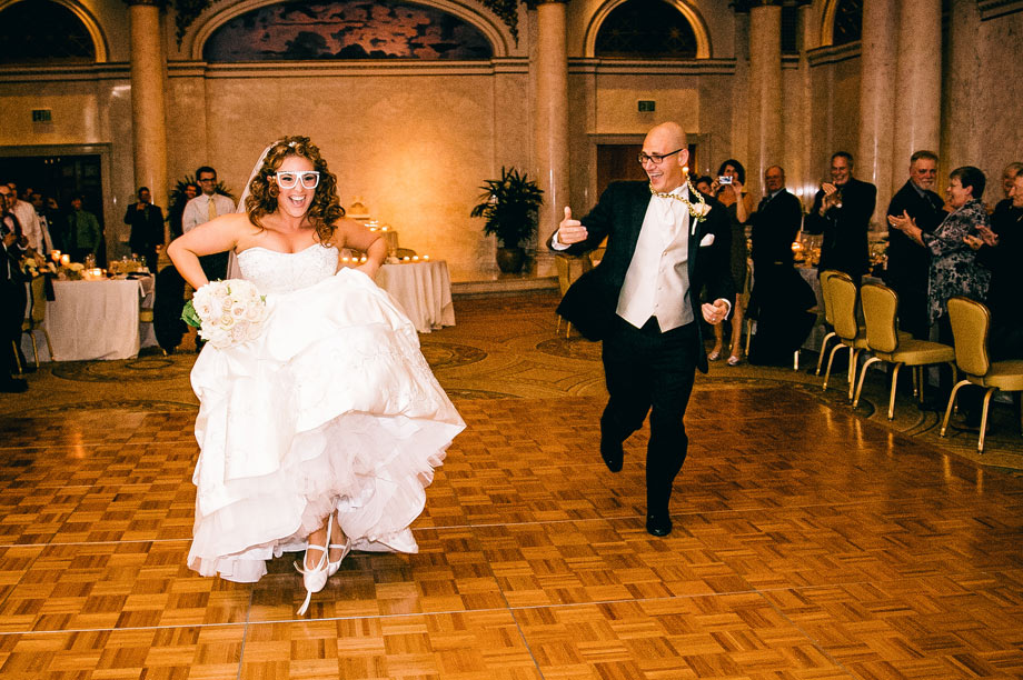 bride and groom dancing with funny glasses