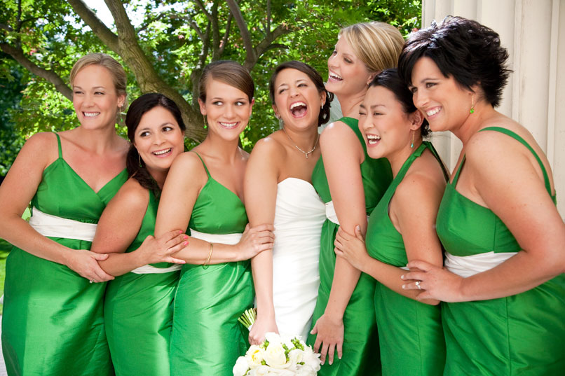 bride with bridesmaids with green dresses