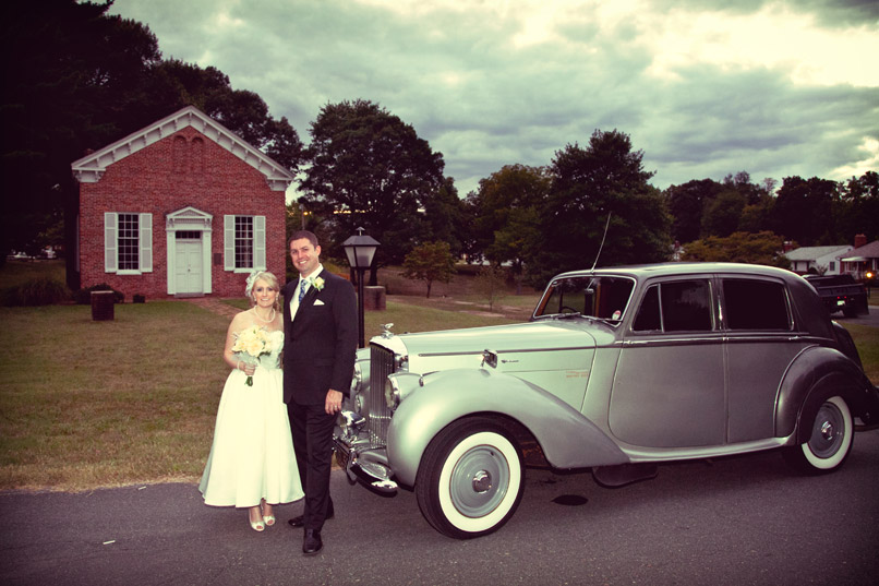 Bride and groom with classic car limo