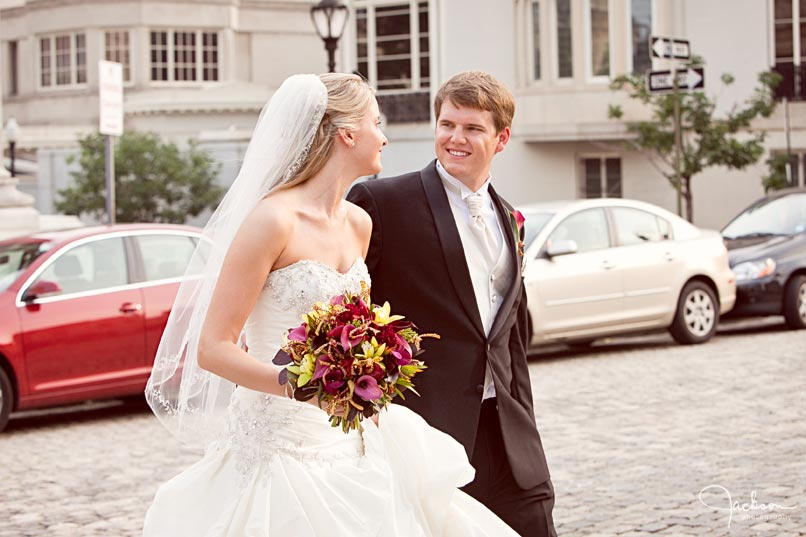 bride and groom walking through mount vernon square