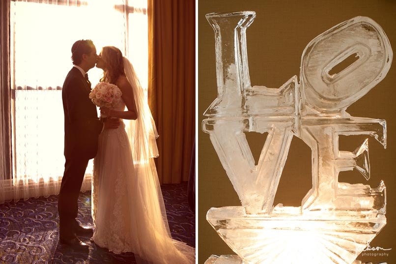 bride and groom kissing by window