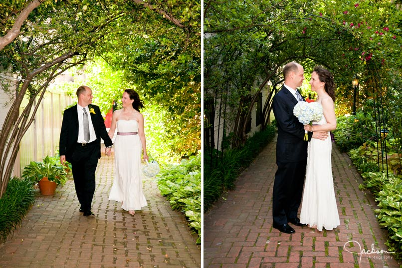 bride and groom walking along the path of chase court