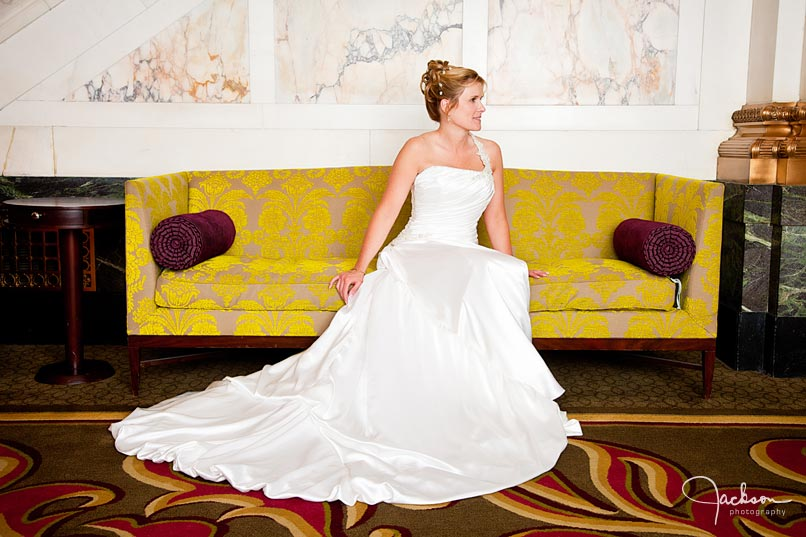 bride on antique yellow couch