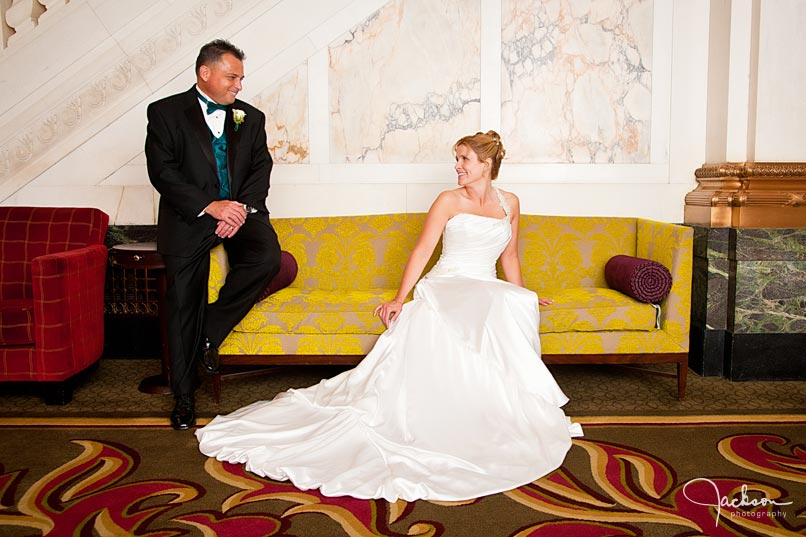 bride and groom on antique yellow couch