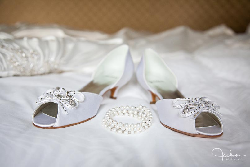 bride shoes and pearl bracelet