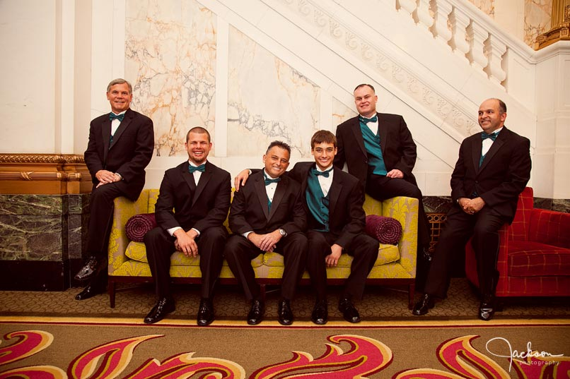 groomsmen on antique sofa