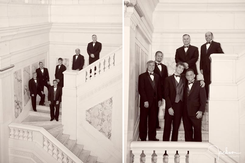 groom and groomsmen on marble staircase