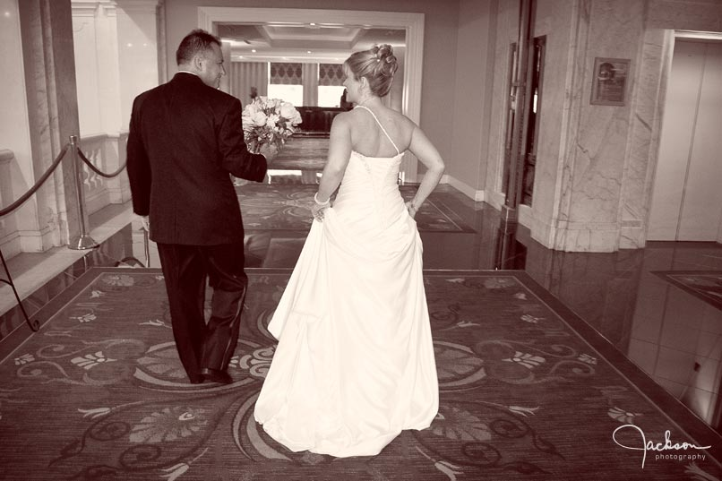 bride and groom exiting reception