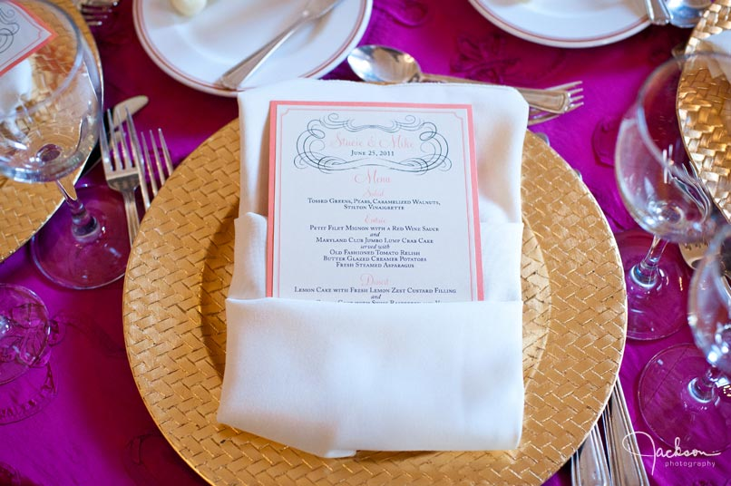 place setting and menu in gold and fuchsia