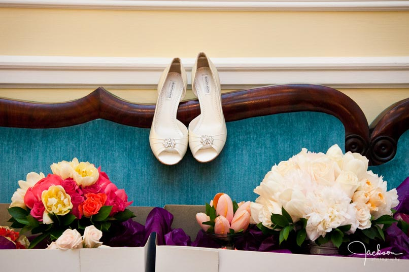 brides shoes flowers on blue couch
