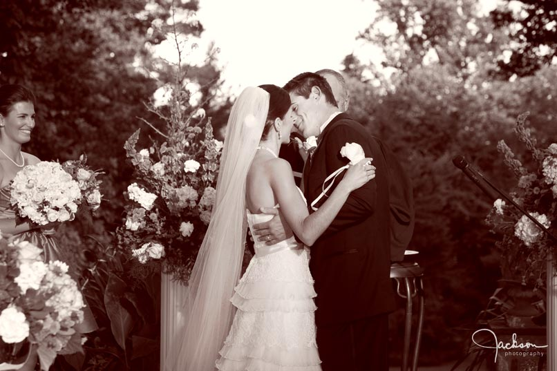bride kissing groom at ceremony