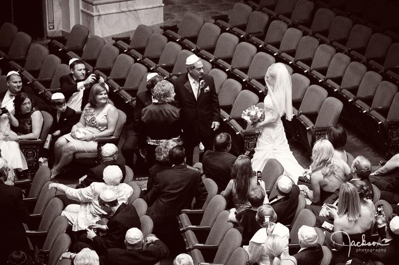 bride walking down theater aisle