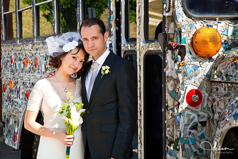 bride and groom in front of visionary bus