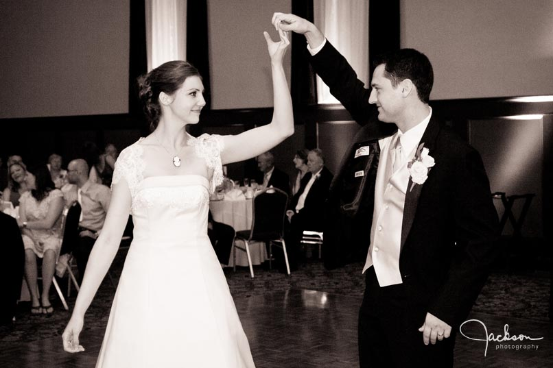 photography of bride and groom first dance black and white