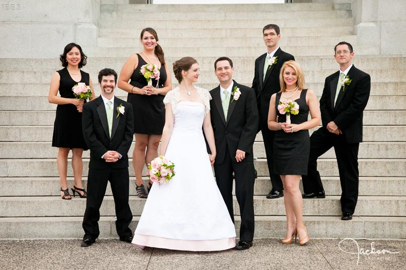photography of bridal party in front of memorial