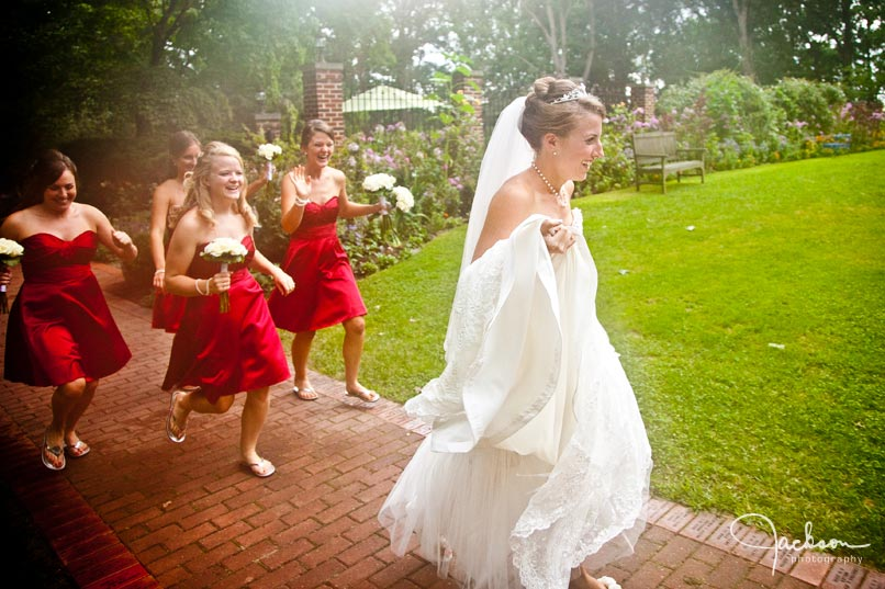 bride running with bridesmaids