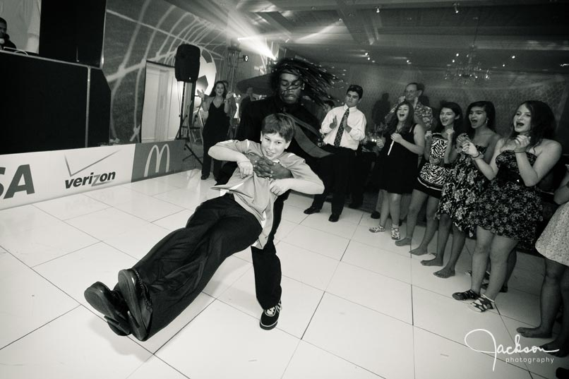 boy being swung around at mitzvah