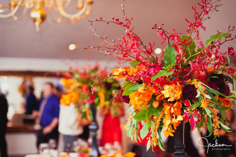 red orange and green fall flower table setting
