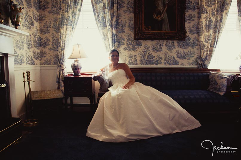 bride sitting on antique chair by window light