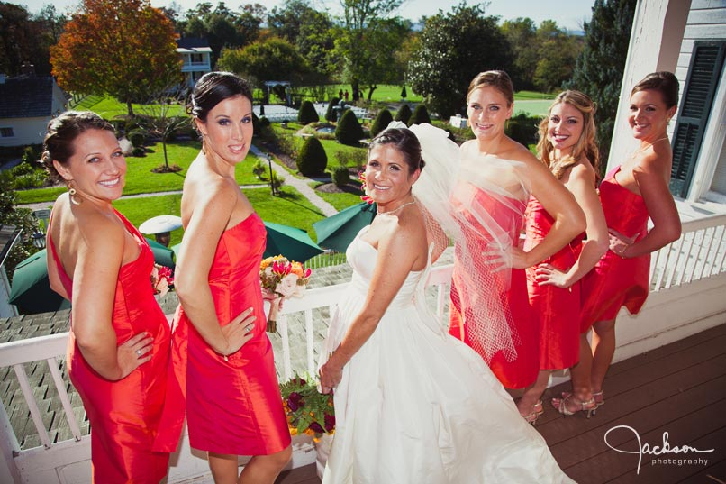 bride and bridesmaids with warm red dresses