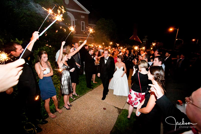 bride and groom leaving with sparklers