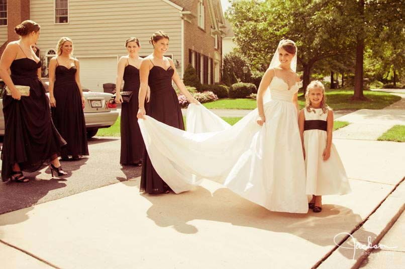 bride and bridesmaids in driveway