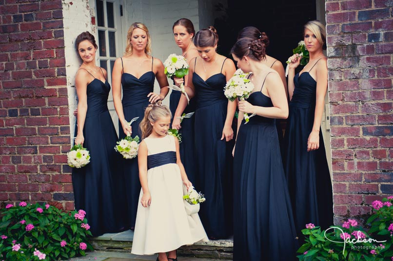 navy blue bridesmaids green and white flowers