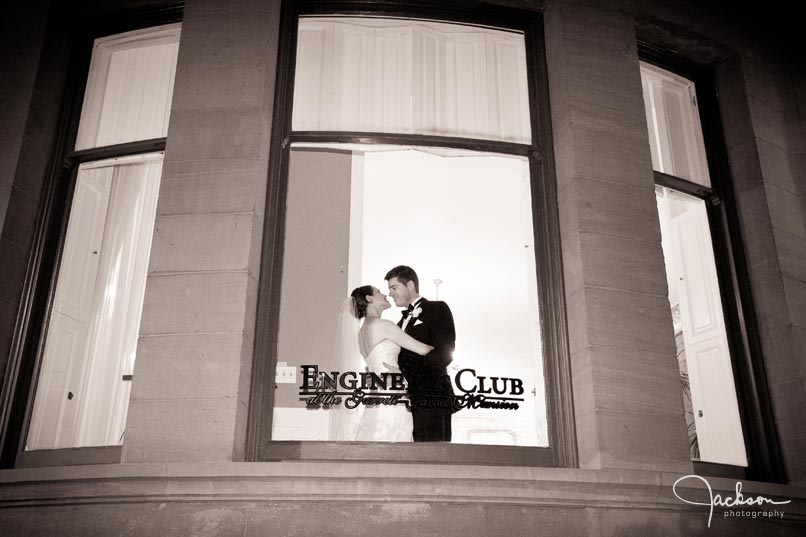 bride and groom in window of engineers club