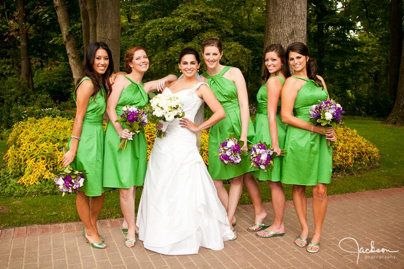 bride and bridesmaids with green dresses