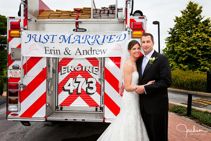 bride and groom in front of firetruck