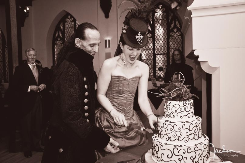 renaissance gothic bride and groom cutting cake