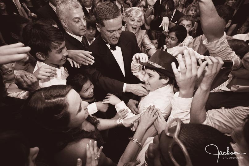 dancers crowding around mitzvah boy