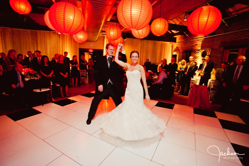 groom spinning bride on dancefloor