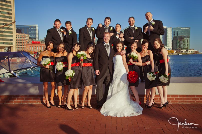 bridal party in red and black