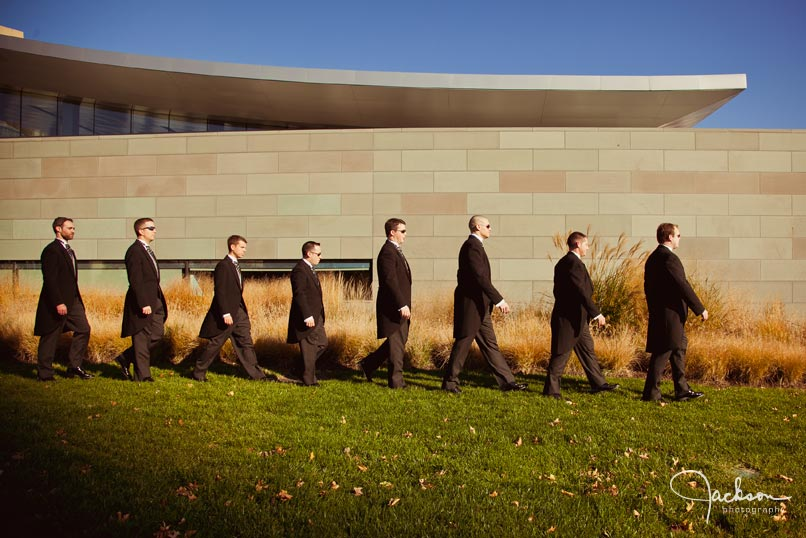 groomsmen walking downtown