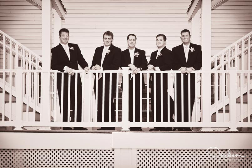 groomsmen on the staircase at the oaks