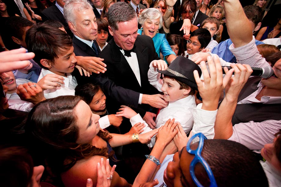 everyone dancing and touching mitzvah boy