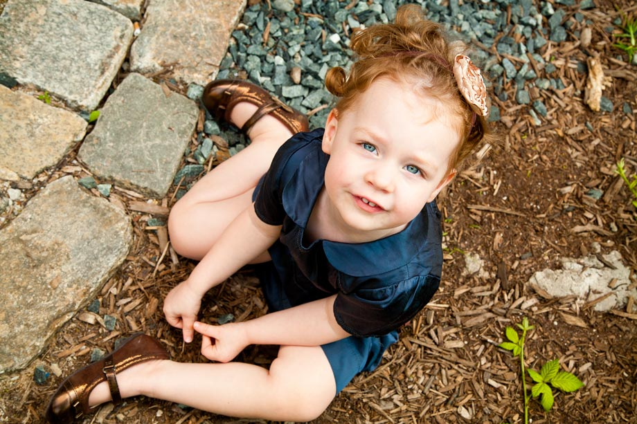 child with red hair and blue eyes