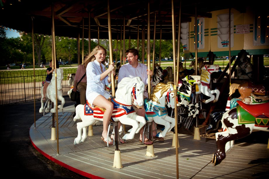couple rideing merry go round