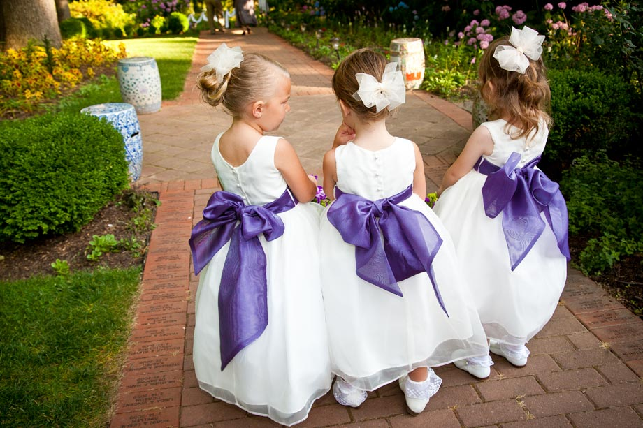 flower girls with purple sashes
