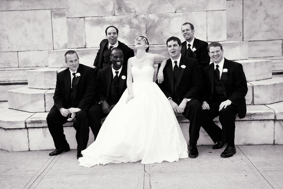 bride laughing with groomsmen