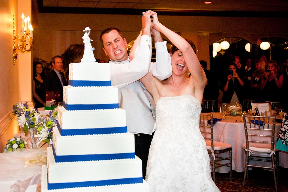 bride and groom cutting cake with axe