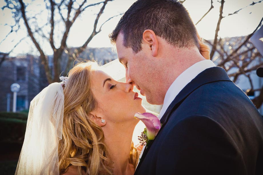 bride and groom kissing close up