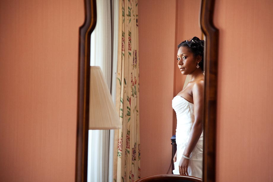 african american bride looking in mirror