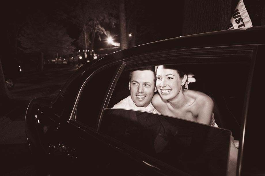 bride and groom leaving in limo