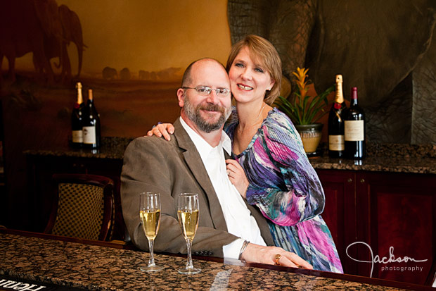 couple sitting with glasses of champagne