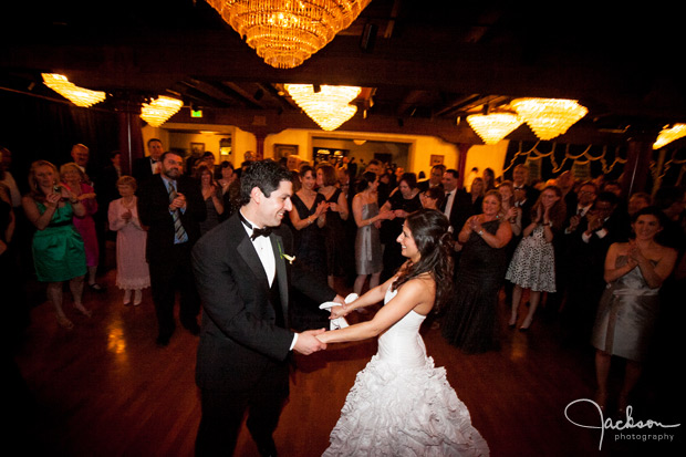 bride and groom dancing among friends