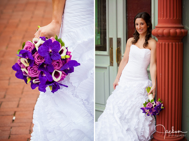 bride posing on column with purple flowers